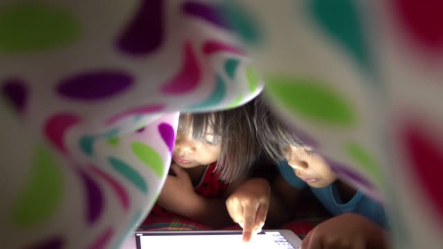 Little girls using tablet video
