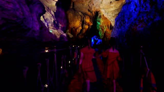 Little girls visit a karst cave,Anshun,Guizhou,China.