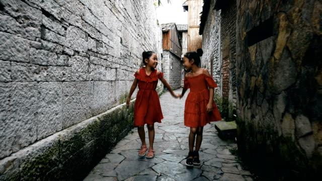 Little girls walking in a old alley,Anshun,Guizhou,China.