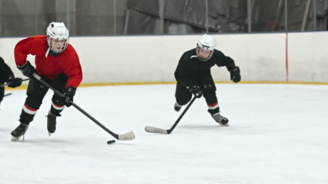 little hockey forward dribbling skillfully - hockey stock videos and b-roll footage