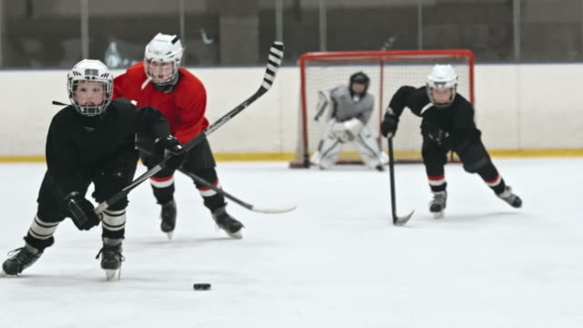 little hockey heroes - hockey stock videos and b-roll footage