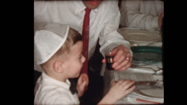 Little Jewish Boy drinks wine at Passover seder video