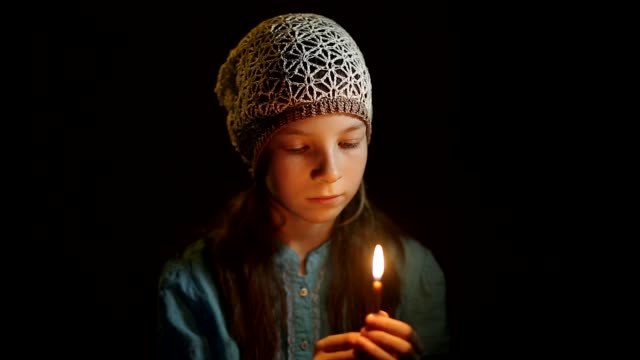 little Orthodox girl praying in a dark room little Orthodox girl praying in a dark room religious text stock videos & royalty-free footage