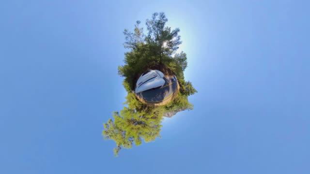 little planet - car in the nature - paesaggio collinare video stock e b–roll