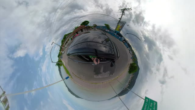 little planet - car in the streets of florianópolis brazil - fish eye video stock e b–roll