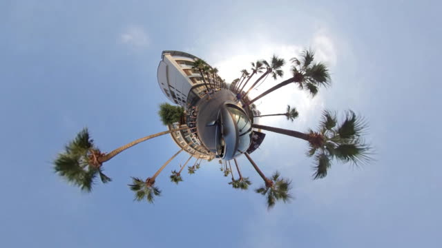 little planet - car in the tropical city - fish eye video stock e b–roll