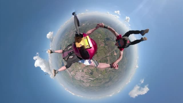 Little planet skydivers having fun 2019 summer diving to the ground stock videos & royalty-free footage
