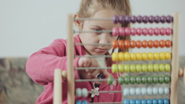 Little preschooler with abacus learning Cute little girl, playing with an abacus at home, sunny living room. stock video... Little preschooler with abacus learning Cute little girl, playing with an abacus at home, sunny living room. genius stock videos & royalty-free footage