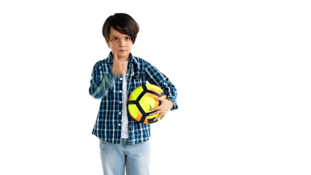 Little soccer player on a white background seriously looking at the camera and gives a thumbs up Little soccer player on a white background seriously looking at the camera and gives a thumbs up. one boy only stock videos & royalty-free footage
