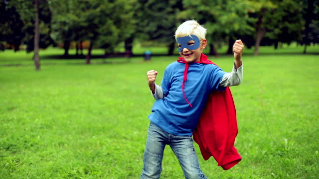 Little Superhero dancing in the park. Little Superhero dancing in the park. conquering adversity stock videos & royalty-free footage