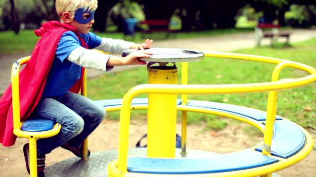 Little Superhero spinning on the carousel. video