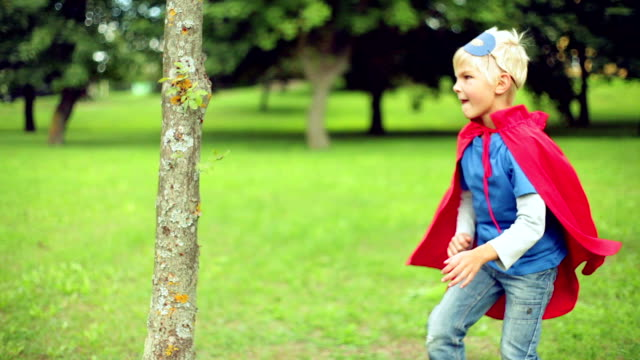 Little superman fighting with the tree. video