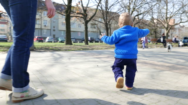 Little toddler boy making his first steps video