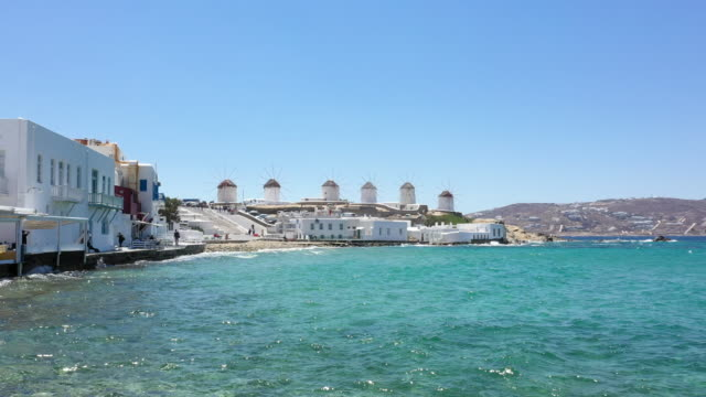 Little Venice and windmills, Mykonos town, Mykonos island, Greece Little Venice and windmills, Mykonos town (Chora), Mykonos island, Cyclades, Greece. greek islands stock videos & royalty-free footage
