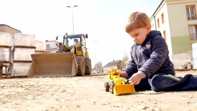 Little worker on construction site video