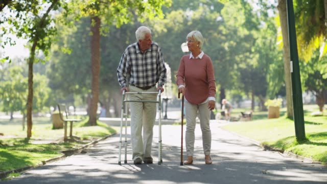 Live a little more 4k footage of a senior couple comically throwing away their walking sticks crutch stock videos & royalty-free footage
