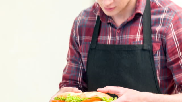 live camera of man with sandwich - cheese sandwich bildbanksvideor och videomaterial från bakom kulisserna