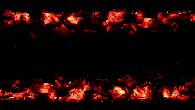 Live coals - Loopable Hot glowing coals line - flaming hot. Loop ready file. coal stock videos & royalty-free footage