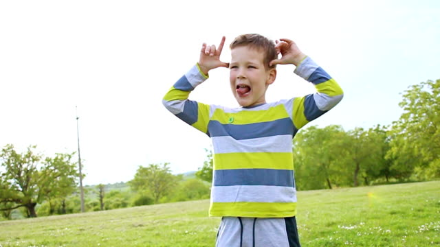 Lively boy fooling around video