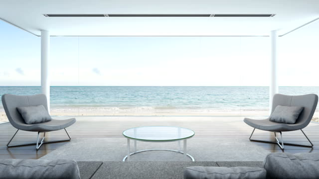 living room in beach house, modern luxury interior with sea view - affluent lifestyles stock videos & royalty-free footage