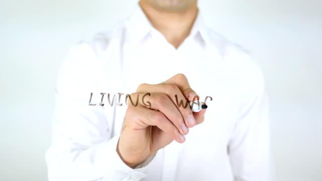 Living Wage, Man Writing on Glass video