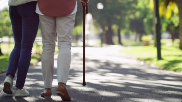 I'll always make time for my mom 4k footage of a senior woman using a cane while out for a walk at the park with her daughter crutch stock videos & royalty-free footage