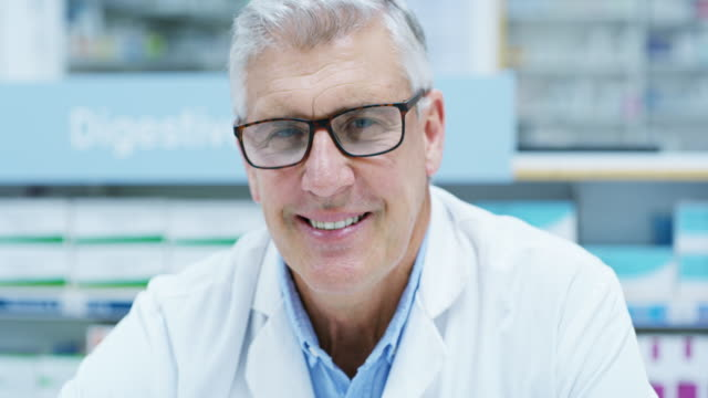 I'll do my best to get you better 4k video footage of a handsome senior male pharmacist working in the pharmacy pharmacist stock videos & royalty-free footage