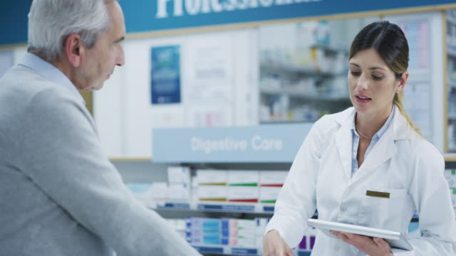 I'll do some research on a generic... 4k footage of a pharmacist assisting an elderly customer pharmaceutical industry stock videos & royalty-free footage