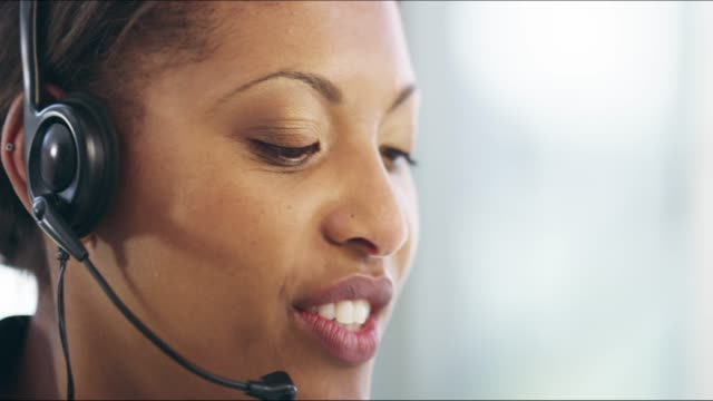 I'll find you a solution 4k video footage of an attractive young female callcenter agent working on a desktop in her office hands free device stock videos & royalty-free footage