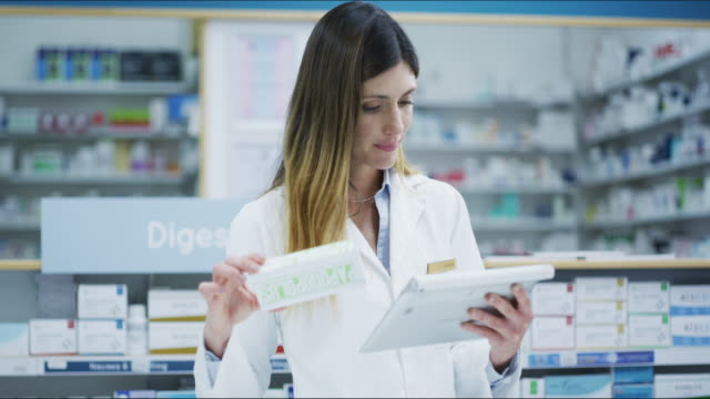 I'll get all the info online for this new product 4k footage of a pharmacist working in a chemist pharmacist stock videos & royalty-free footage