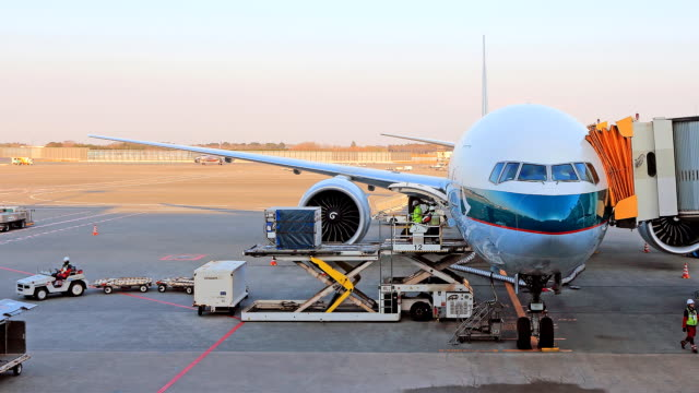 load and unload cargo to airplane for air freight logistic video