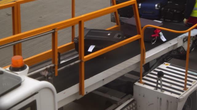 Loading luggage to aeroplane video