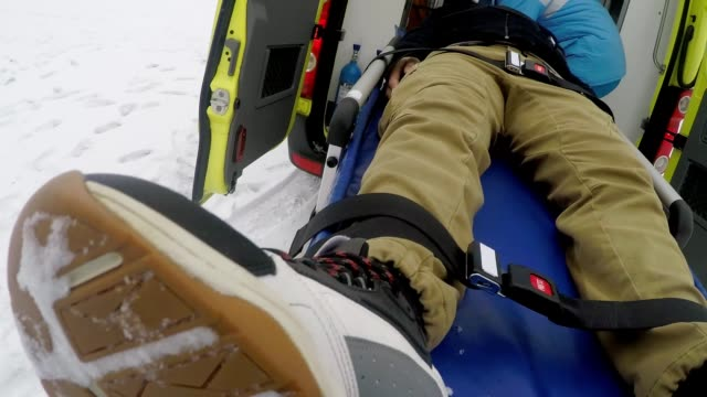 pov of emt loading man on stretcher into ambulance - first responders стоковые видео и кадры b-roll
