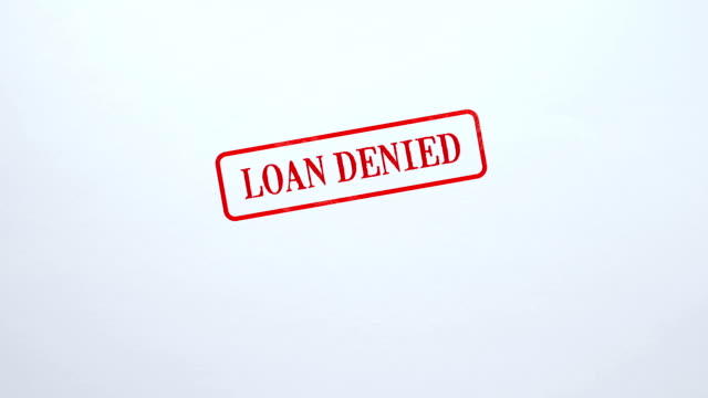 loan denied seal stamped on blank paper background business document prohibition - proibizione video stock e b–roll