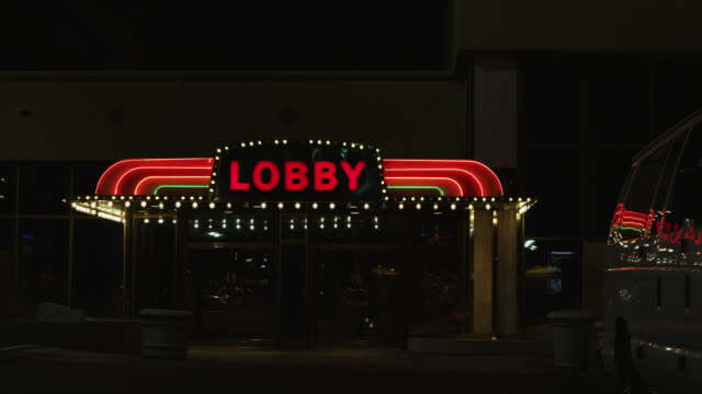 Lobby entrance Wide shot of a lobby entrance, night. entrance stock videos & royalty-free footage