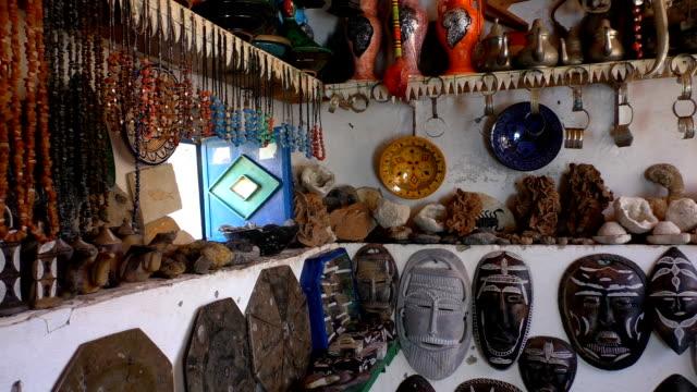 local artisan souvenir shop display in morocco - souk video stock e b–roll