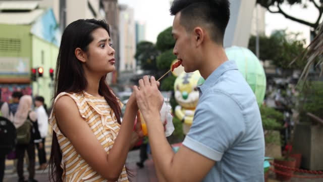 Local Couple eating street food at the Jalan Petaling market video