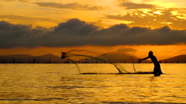 Local lifestyles of fisherman working in the morning sunrise. video