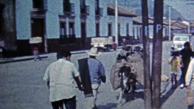 1974: Local townspeople carrying things on their heads. video