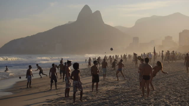 Locals Playing Ball at Famous Ipanema Beach at Sunset, Rio de Janeiro, Brazil Locals playing ball at famous Ipanema Beach at sunset in Rio de Janeiro, Brazil. brazil stock videos & royalty-free footage