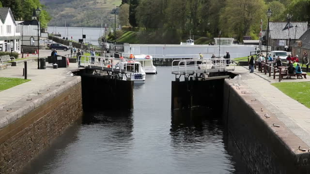 Lock gates closing Caledonian Canal Fort Augustus Scotland UK video