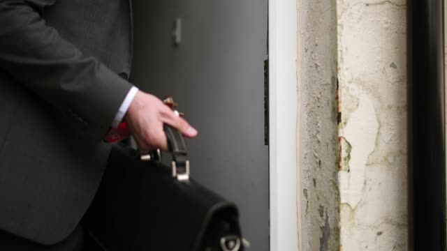 Locking the Door Close-up of an unrecognisable person walking out their front door and locking it. front door stock videos & royalty-free footage