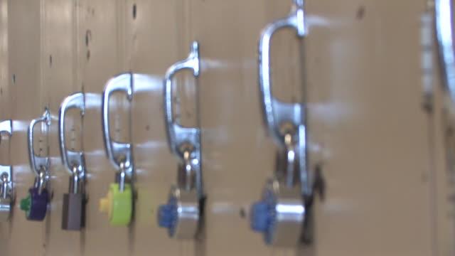 Locks 2 Locks on lockers in a high school. locker stock videos & royalty-free footage
