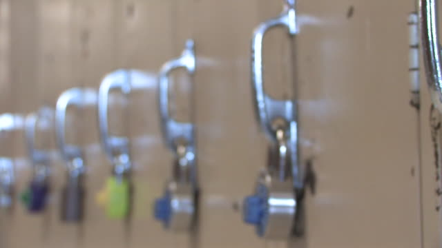 Locks 3 Locks on lockers in a school. locker stock videos & royalty-free footage
