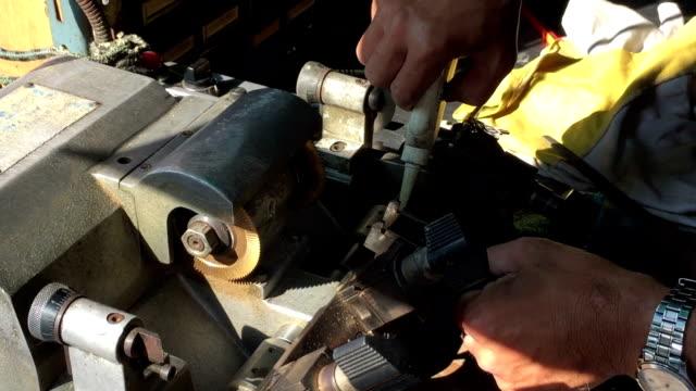 Locksmith making key by machine video