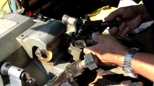 Locksmith making key by machine key maker grinder industrial equipment stock videos & royalty-free footage