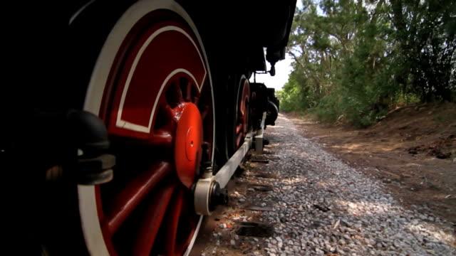 locomotive running down railroad tracks video