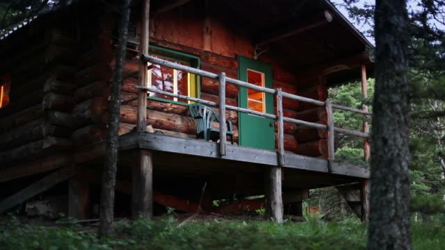 Log cabin at dusk
