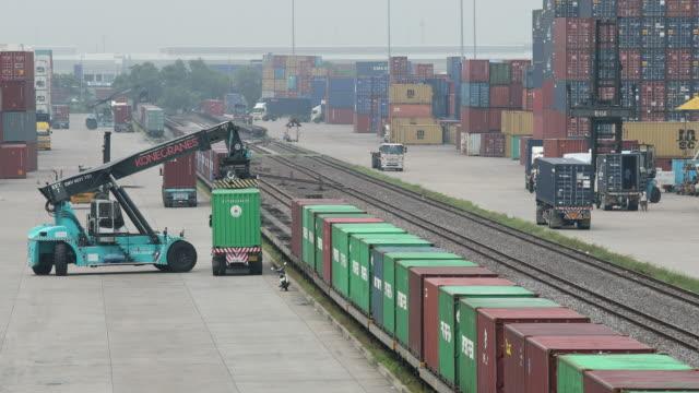 Logistics container operation in railroad cargo video