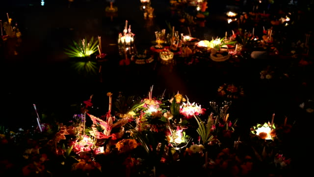 Loi Krathong festival in Chiangmai Thailand, floating basket of flowers on river during celebrated and floating lanthernon Thai full moon lunar calendar.